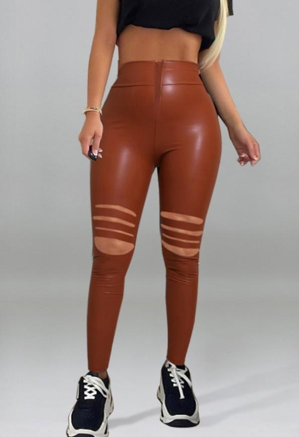 Herbstbraune Leder-Leggings mit hoher Taille und Rissen