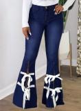 Pantalones vaqueros de campana con abertura y hendidura de vendaje azul oscuro de otoño