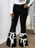 Pantalones vaqueros con parte inferior de campana con abertura y vendaje negro de otoño