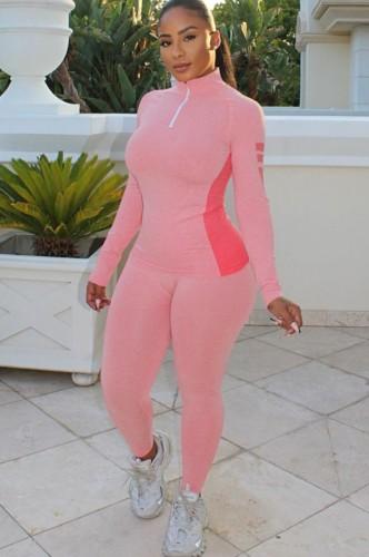Herfst roze kraag met ritssluiting en contrasterend trainingspak met lange mouwen en broek
