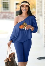 Conjunto de pantalones a media pierna y top de manga larga con hombros descubiertos y calabaza de Halloween azul de otoño