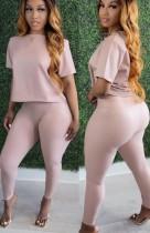Set di pantaloni skinny a vita alta e top a maniche corte in pelle sintetica rosa alla moda autunnale