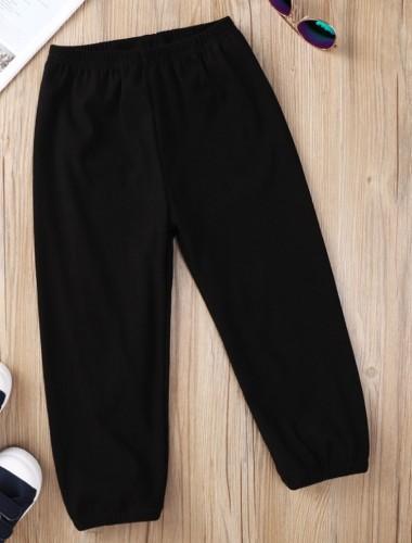 Pantaloni da bambino neri con cinturino alla caviglia