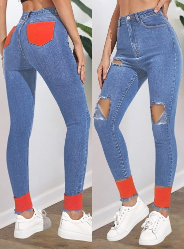 Herbstblaue Jeans mit Cut-Outs und beschädigtem Kontrast mit hoher Taille