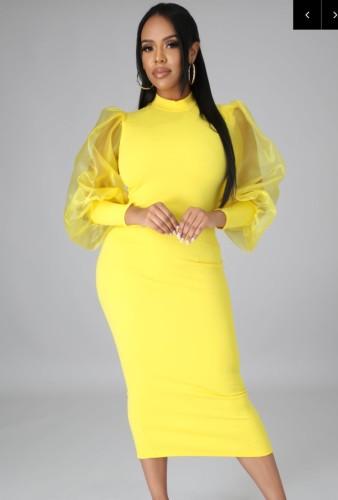 Abito longuette elegante con maniche a sbuffo giallo formale autunnale