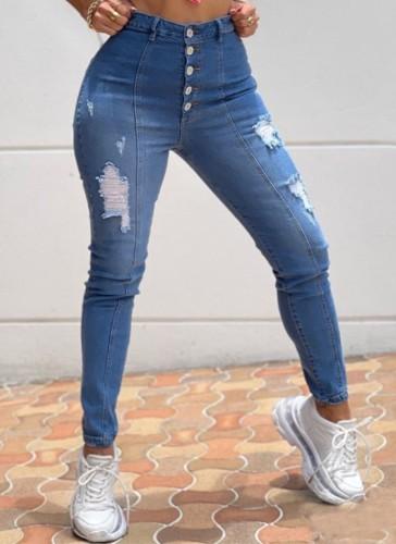 Jeans de cintura alta rasgados con botones azules de invierno