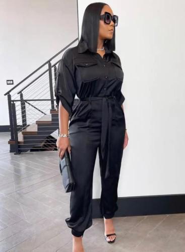 Herbst Plus Size Trendy schwarzer Turndown-Kragen-Jumpsuit mit halben Ärmeln und Knöpfen