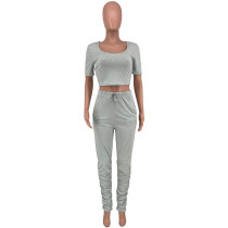 Solid Color Low-cut Crop Top and Pleated Trousers
