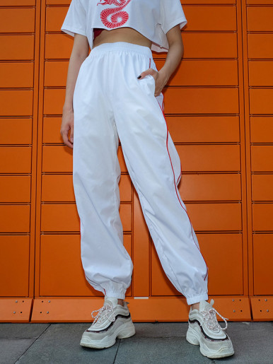 Joggers with Piping Detail In White